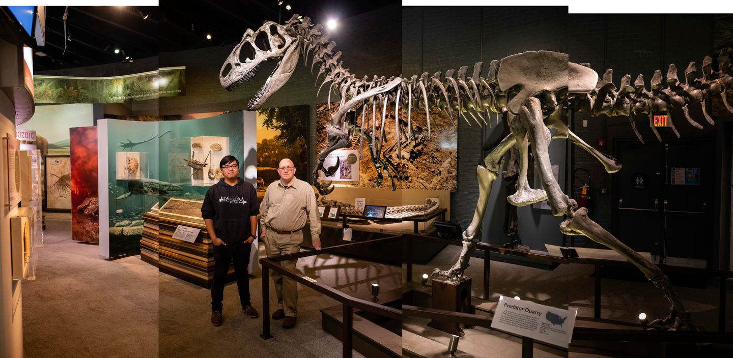 Paleontologists Gabe Santos and Andy Farke stand for a portrait next to a Tyrannosaurus Rex skeleton at the Raymond Alf Museum of Paleontology on the campus of the The Webb Schools in Claremont, CA.